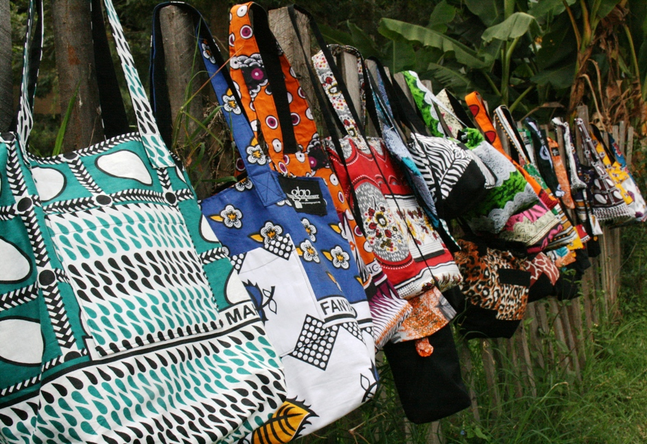GBP kanga-cloth bags on a Kenyan fence